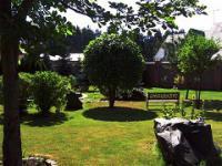 Озеленение и благоустройство территории у частного дома.
